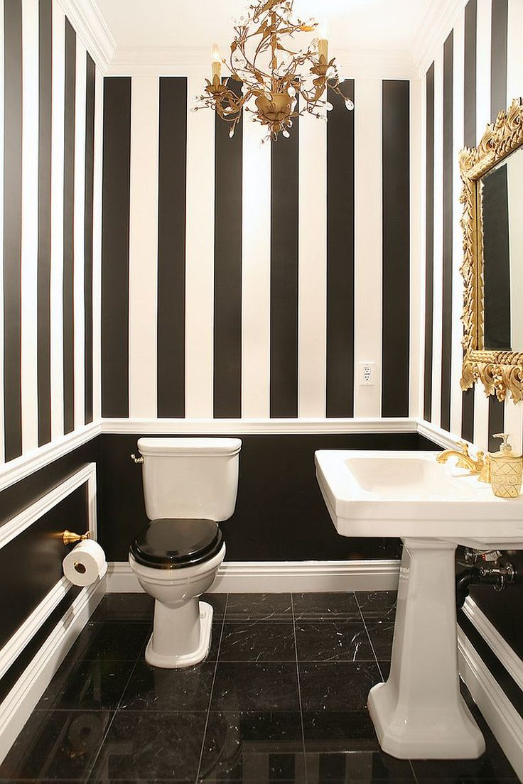 Gold coupled with black and white in the lovely powder room