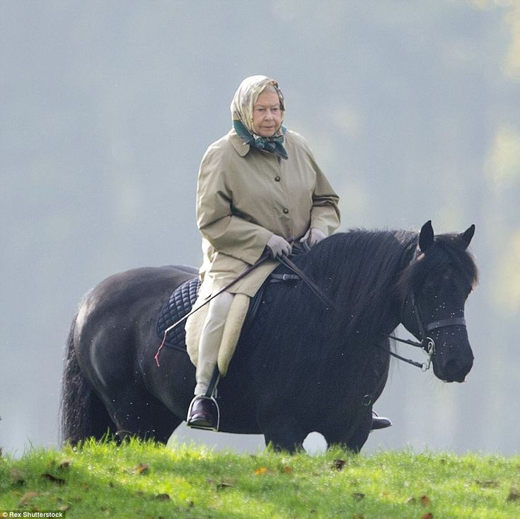 The Queen, 89, was pictured riding by the River Thames today in Windsor, Berkshire, wearin...
