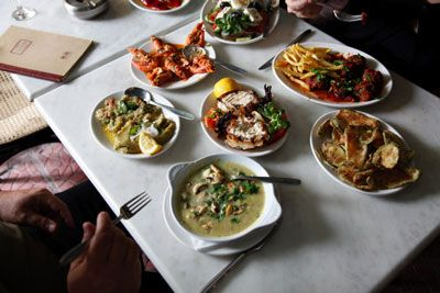 An assortment of mezedes, including zucchini fritters and keftedes, or meatballs, at Ouzeri Aristotelous, in Thessaloniki.