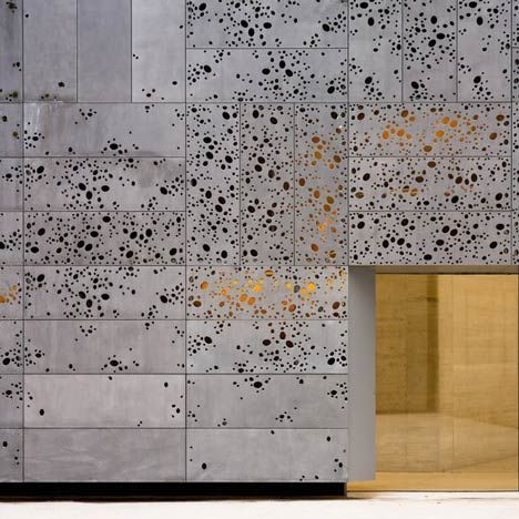 Moss is expected to grow on the perforated aluminium skin   how to merge a building with its natural surroundings