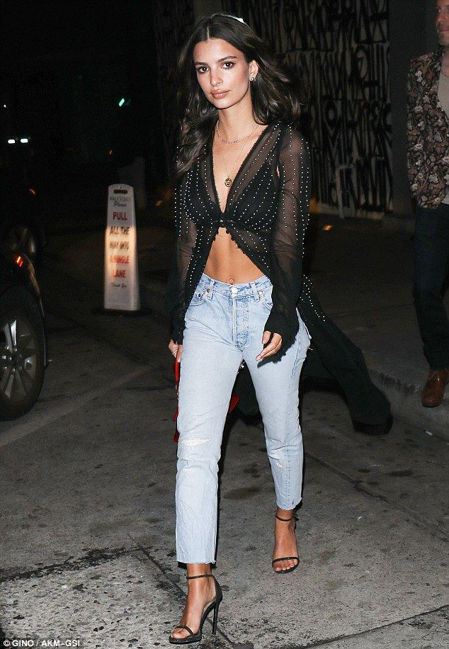 Runway night out:on Friday, Emily Ratajkowski flashed her sculpted mid-section in a sheer...