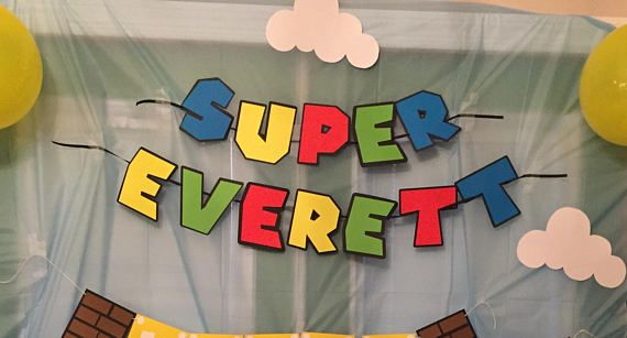 This colorful banner is perfect for any Super Mario or Mario Cart Themed Birthday Party! --> Feature colors of this banner include: Bright Red, Light Green, Bright Blue & Neon Yellow with a Black outline and backing to each letter --> Customizable Name Portion --> The SUPER portion