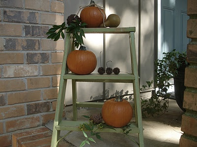 Love the pumpkins and gourds on the ladder.