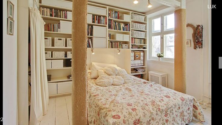 Old bedroom, before renovation. The kitchen is behind the bookshelfs.