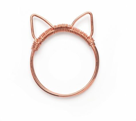 http://www.cutoutandkeep.net/projects/cat-ring Cat Ring how to  Cat ears turn this simple wire ring into something extra special.   Wire alone can make the best jewelry; simply take two gauges of wire and create a cute, quirky ring.  18 gauge (SWG 19, 1mm) wire would work but it will be harder to form into the initial shape as thicker wire is stiffer to start