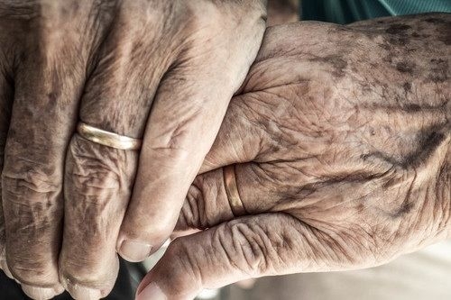 Old couple holding hands. Precious.