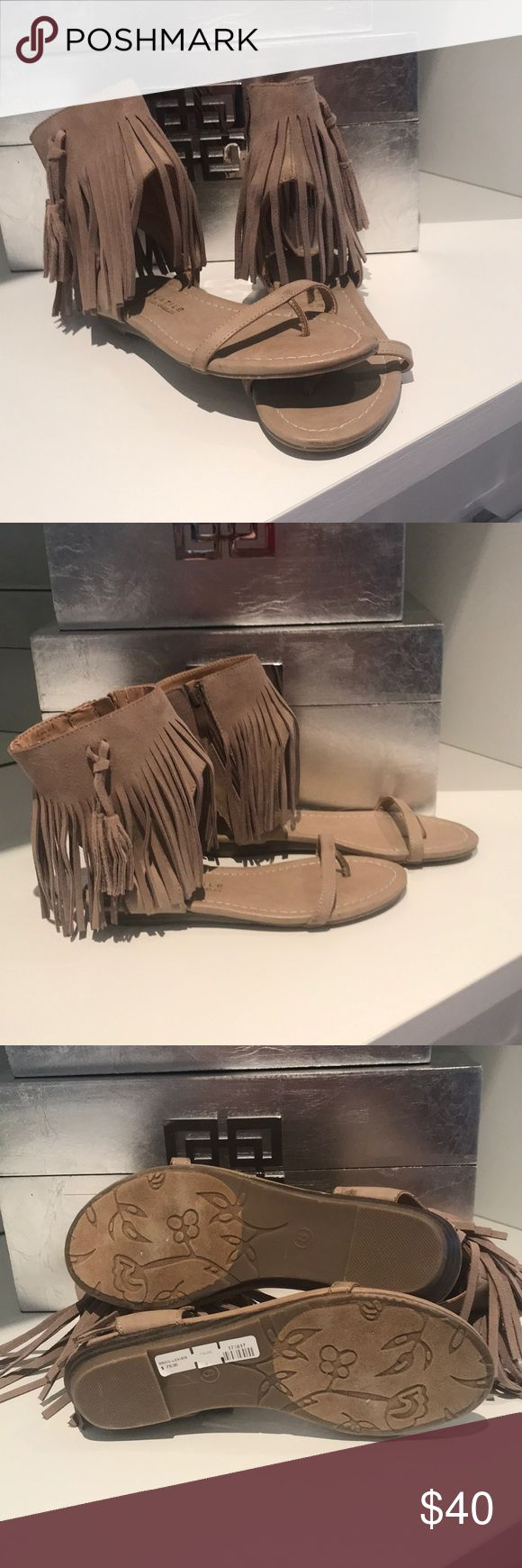 Fringe zip up sandals Suede neutral fringe ankle zip up with tassels. Single strap with big toe support  slight wedge heel and cushioned soles. New with tags very volatile Shoes Sandals