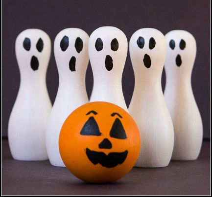 DIY Ghost Bowling Set | Add this one to your Halloween party ideas list. A fun wooden craft that's simple to make!