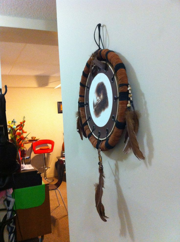 Side view of the falcon. We made the frame from an old steering wheel cover, and a leather coat. Recycle reuse!