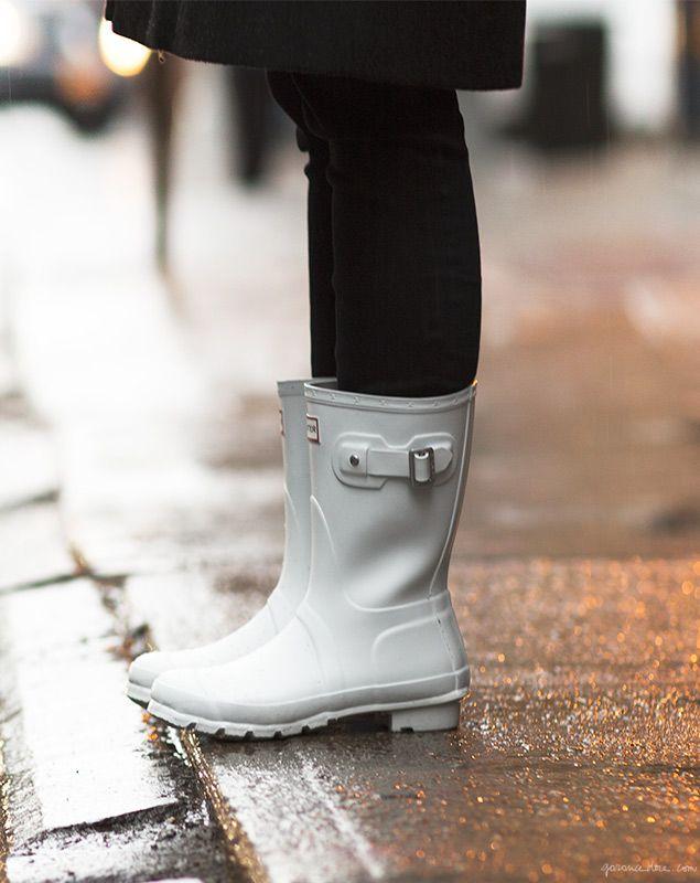 Hunter rain boots, black jeans, rain coat / Garance Doré