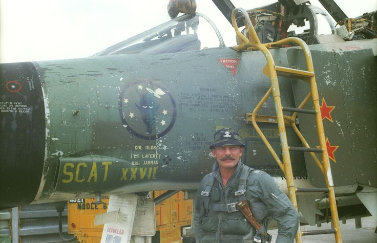 Col. Robin Olds with his F-4C SCAT XXVII, which is on display at the National Museum of the U.S. Air Force. Olds named all his aircraft after his West Point roommate Scat Davis, who could not become a military pilot due to poor eyesight. (U.S. Air Force photo).