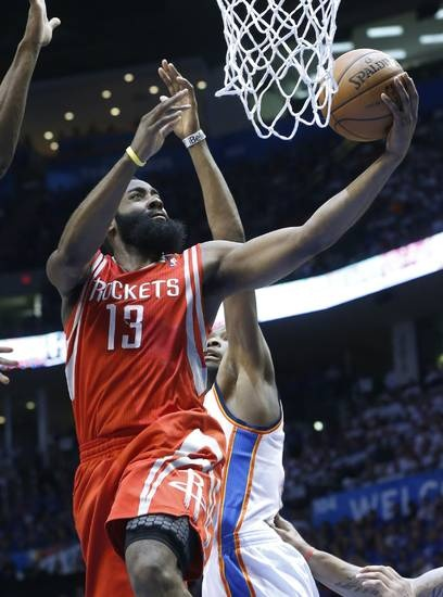 Houston Rockets guard James Harden (13) shoots in front of Oklahoma City Thunder forward Kevin Durant in the second quarter of Game 2 of their first-round NBA basketball playoff series in Oklahoma City, Wednesday, April 24, 2013. (AP Photo/Sue Ogrocki)