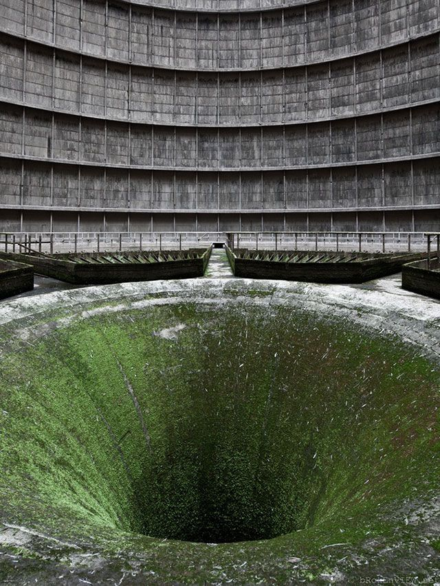 """This photo of an abandoned construction of a nuclear power plant still generates feelings of horror with it's circular walls that funnels into a seemingly bottomless, black hole. From Francesco Mugnai's blog, """"33 more breathtaking and incredible photos of abandoned places."""" Photo by Brokenview"""