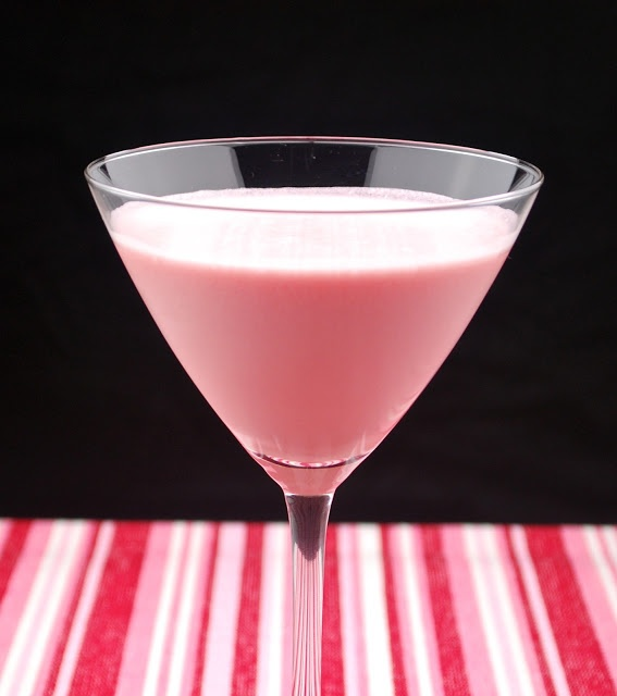 Pink Chocolate Martini (•1 ounce vanilla vodka •1-1/2 ounces crème de cacao •1/2 ounce amaretto •1/2 ounce grenadine syrup •4 tablespoons Cool Whip)