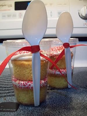 "cupcakes in a plastic cup...i saw something similar to this yesterday at a school bake sale, except there was one cupcake, it was unfrosted.  the large, lidded plastic cup was upside down and then there were 2 tiny lidded cups inside and on top of the cupcake. one had frosting and one had sprinkles.  there was a knife attached to the outside like this spoon and a tag that said, ""decorate your own cupcake."" so cute....wish i had thought to take a picture."