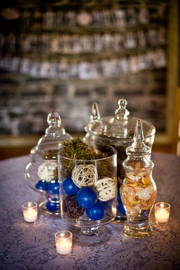 no flower centerpiece idea. Like this with my colors and with the flower peddles that bobby has gotten over the past few years... :)