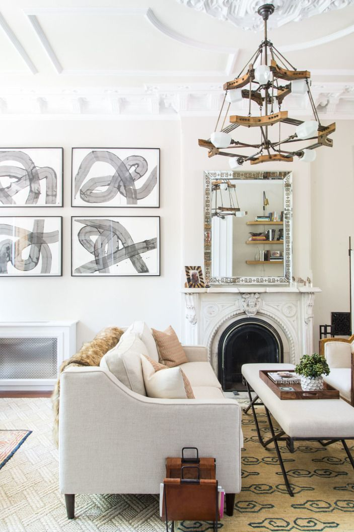 """The vintage chandelier, along with most of the lighting fixtures, were replaced by custom pieces by Paul Pisanelli. Louisa fell in love with his work when she found him at the Brooklyn Flea. The abstract artwork is by <a href=""""http://www.eugeneconstan.com"""" target=""""_blank"""">Eugene Constan</a>."""