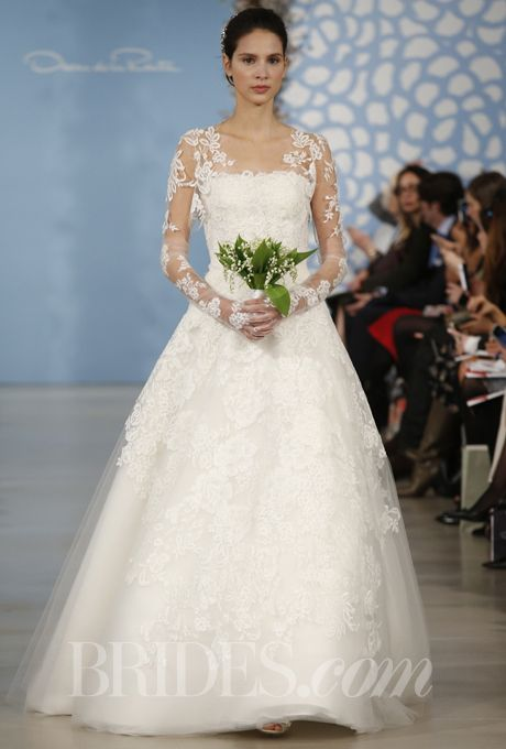 """Brides.com: Our Favorite Lace Wedding Dresses from the Bridal Runways. """"Ashton"""" ivory lyon Chantilly lace, rose corded Chantilly lace, and bouquet Chantilly lacy layered applique degrade tulle strapless gown with illusion sleeve jacket, Oscar de la Renta  See more Oscar de la Renta wedding dresses."""
