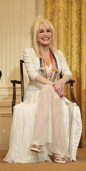Parton during a reception for The Kennedy Center honorees in the East Room of the White House in Washington, D.C., on December 3, 2006