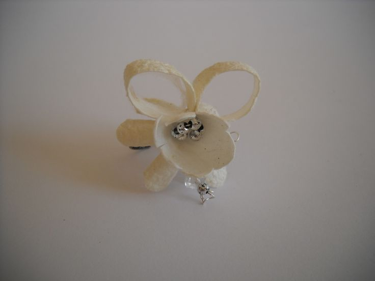 Handmade ring with wight silk cocoons.