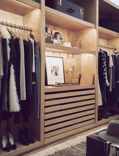 Custom walk-in closet with skinny drawers perfectly keeps all your clothes and jewelery organized. Display area adds style to your closet. Hang bar area and upper open cubbies for storing hats, off-season items, and luggage.