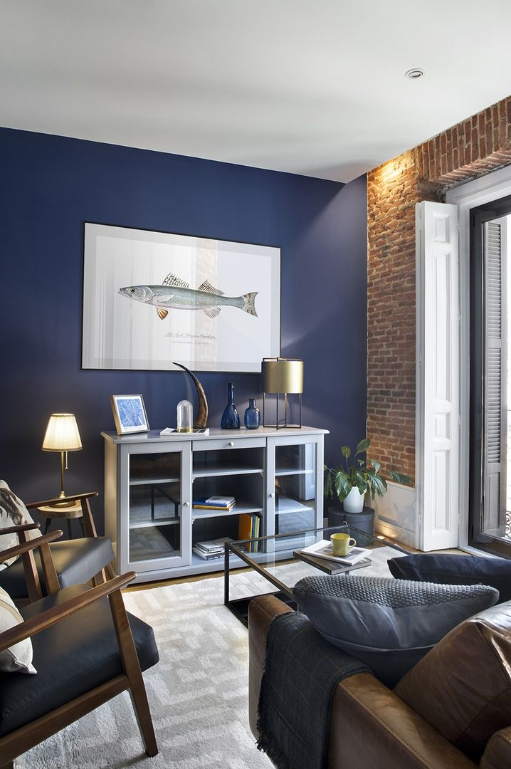 Loft Inspired Living Room With Exposed Brick Wall And Blue Accents Nonagon Style Blue Walls Living Room Blue Living Room Brick Living Room
