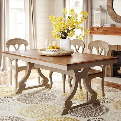 Rustic and civilized all at once, with a sturdy hardwood base and scrolled legs, our hand-finished Marchella extension table is a super-inviting space-saver. Pair it with our matching chairs, or mix things up for a cheerful, eclectic look. Accommodates up to 8 with a big, warm hug.