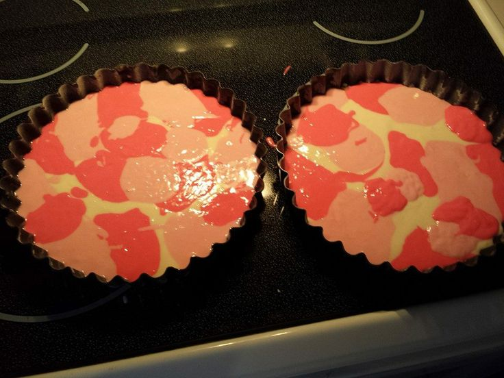 Pink Camo cakes. 1)Mix a white box cake and separate into 3 bowls. 2)Set one bowl aside leave white.  3)Add 2 drops of red food coloring to 2nd bowl and mix well. 4)Add 7 to 10 drops to the 3rd bowl. 5)Drop Spoonfuls randomly in cake pan.  TIP-Layer lighter pink on top of darker pink.