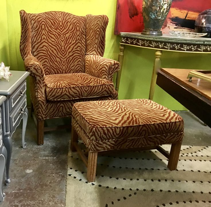 "Coal Chippendale Fireside Wingback Armchair With Animal Print On Sale   32"" Wide x 24"" Deep x 40.5"" High   Was $575 Sale Price $275  Rick's Antiques and Home Decor, Dealer #36  White Elephant Antiques  1026 N. Riverfront Blvd. Dallas, TX 75207"