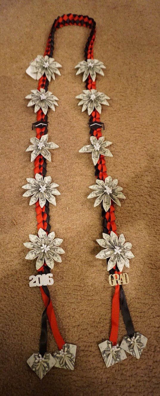 Money lei for all occasions. Red and black ribbon with graduation details. ($50 total)