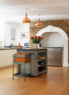 The combination of exposed brickwork and polished copper come together with the stainless steel Mercury range cooker to create some really characterful industrial details in this kitchen.