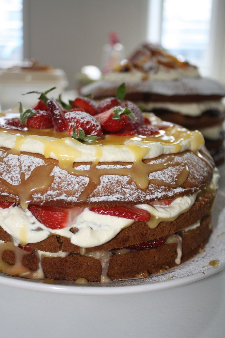 Lemon almond cake with curd and fresh strawberries.