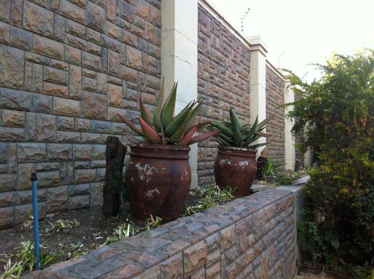 Brick exterior boundary wall designs google search - Exterior brick wall design ideas ...