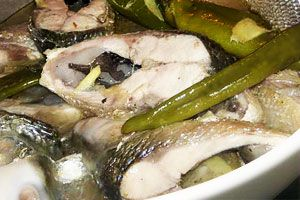 Paksiw - Generally means to cook and simmer in vinegar. Common dishes bearing the term, however, can vary substantially depending on what is being cooked. Paksiw na isda is fish poached in a vinegar broth usually seasoned with fish sauce and spiced with siling mahaba and possibly containing vegetables.