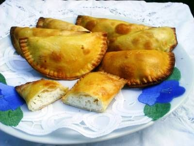 """#Sweet #Fiadoni Easter Pastry - Life in Abruzzo. Events and #Traditions -Ingredients ________________________________________ For pastry dough  2 eggs 2 tablespoons vegetable oil 2 tablespoons sugar Four as needed (about 1 1/2 cups)  For filling  1 egg 1 container of ricotta, strained 4 teaspoons sugar  * Fiadone (singular) or fiadoni (plural) were originally known as """"h'iatun'"""" or """"hiadone"""" in the Molise countryside. However tourist brochures from this region now refer to them as """"fiadone."""""""