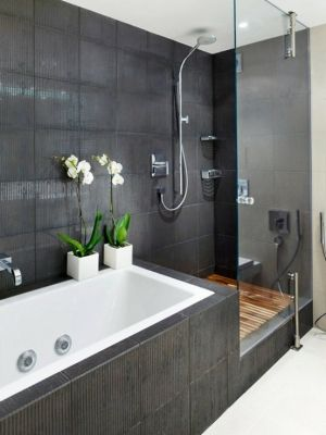 Love how the bath and shower are separate but are in the same wall. This would be a pretty simple design to do. I'm in love with the grey tiles too.