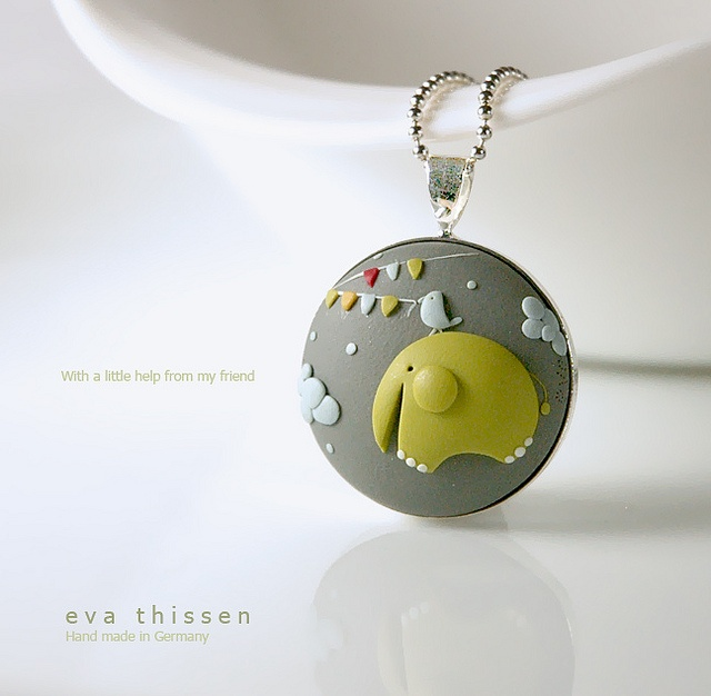 Whimsical hand made polymer clay necklace.