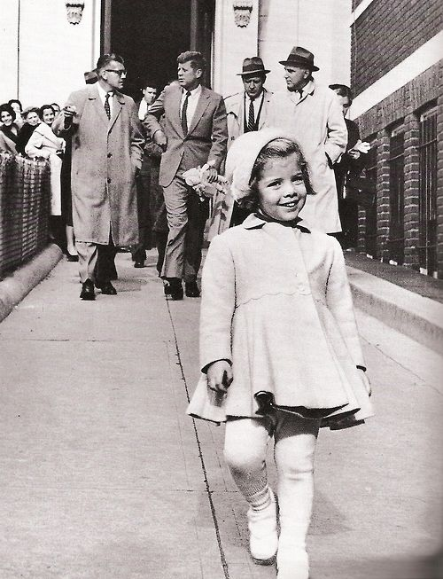 Miss Caroline Kennedy has the president carry her doll.