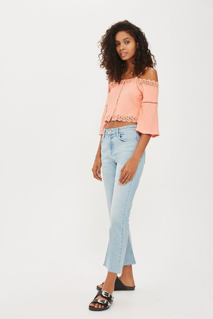 Look to cheerful coral tones with this charming cold shoulder bardot top. A dream in balmy weather, this graceful crop top features buttons through the front, slender spaghetti straps, pretty crochet trims, and eyelet detailing to the sleeve. Team yours with light denim separates for sunny days.