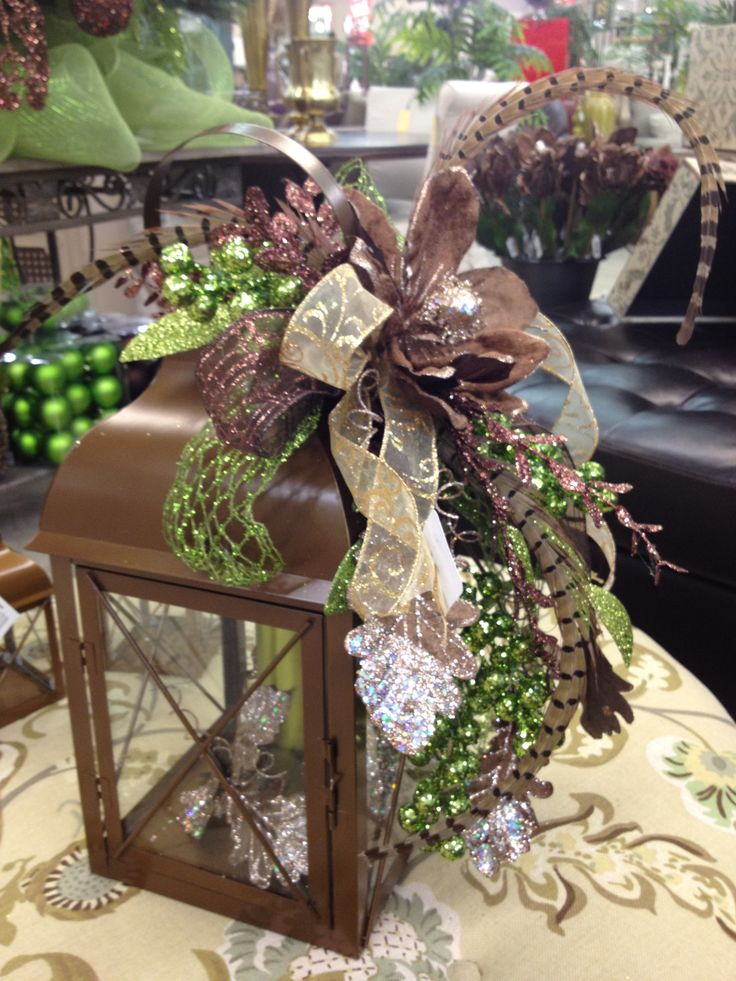 Lantern arrangement. Green  brown with pheasant feathers.  #Christmas #decor