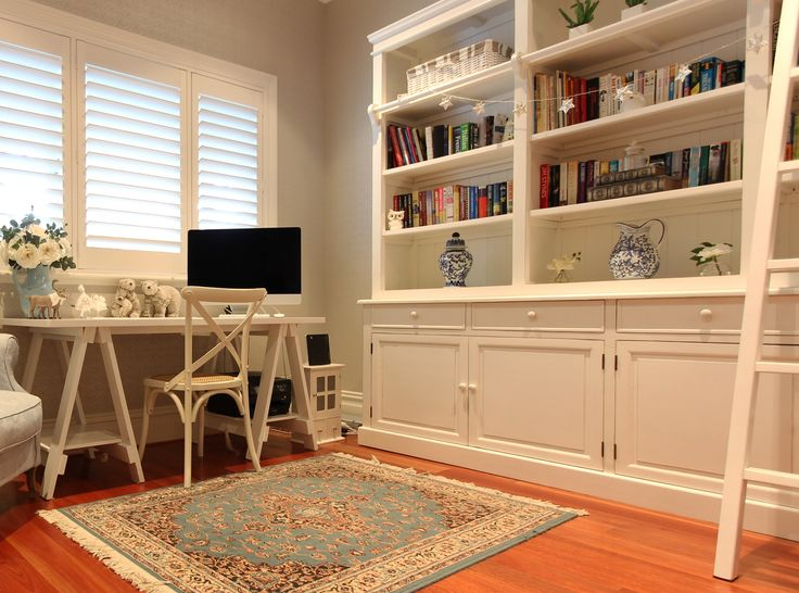 A large white library and soft blues and white for this Hamptons style study