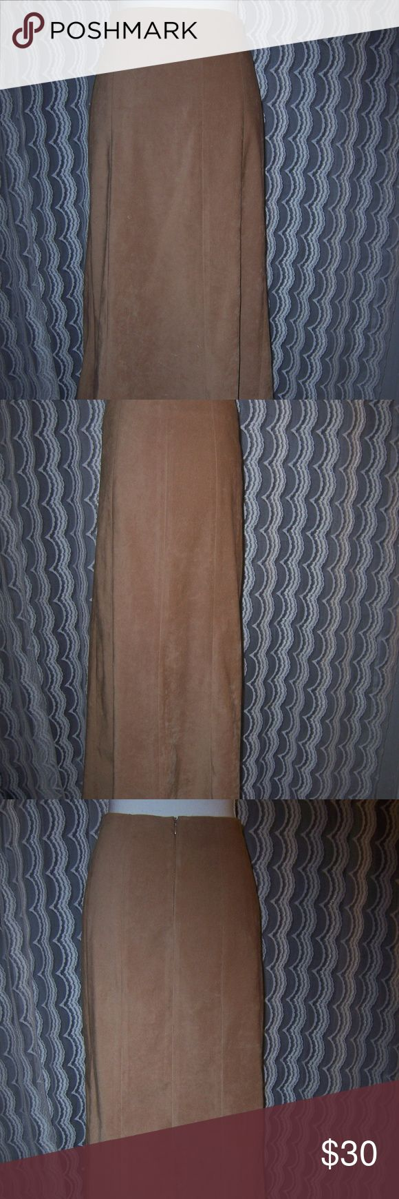 Cato Tan Suede Like Maxi Skirt Sz 8 Women's long tan maxi skirt Cato brand  Size 8 Soft suede like fabric  Polyester / spandex blend  Skirt is unlined but photo 5 shows the backside of fabric which has a gold color to it  Back zipper closure  Perfect for upcoming cooler weather ! Measures about 36 inches long waist to hemline  Measures about 15 1/2 inches across or 31 inches around at the waist  Hips measure about  20 inches across or 40 inches around Cato Skirts Maxi