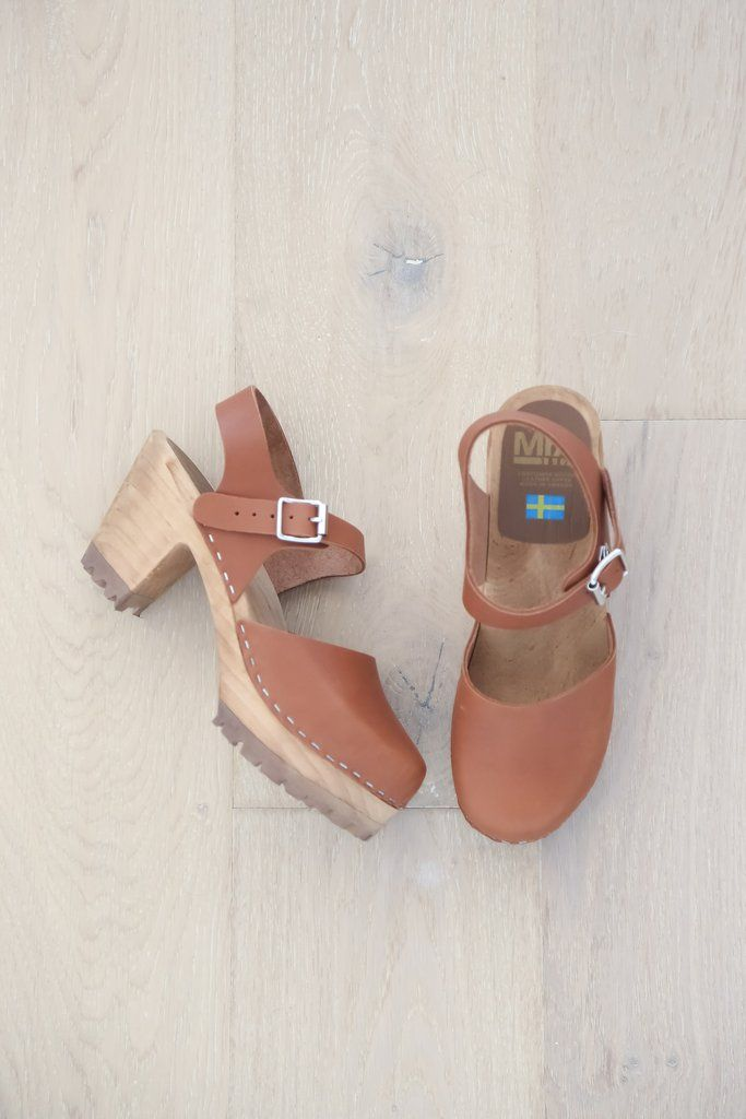 The MIA Abba Swedish wooden clog with a cap toe front and a modern tractor sole, brings back the 70's groovy style. This authentic clog has a leather ankle strap with an adjustable buckle closure and