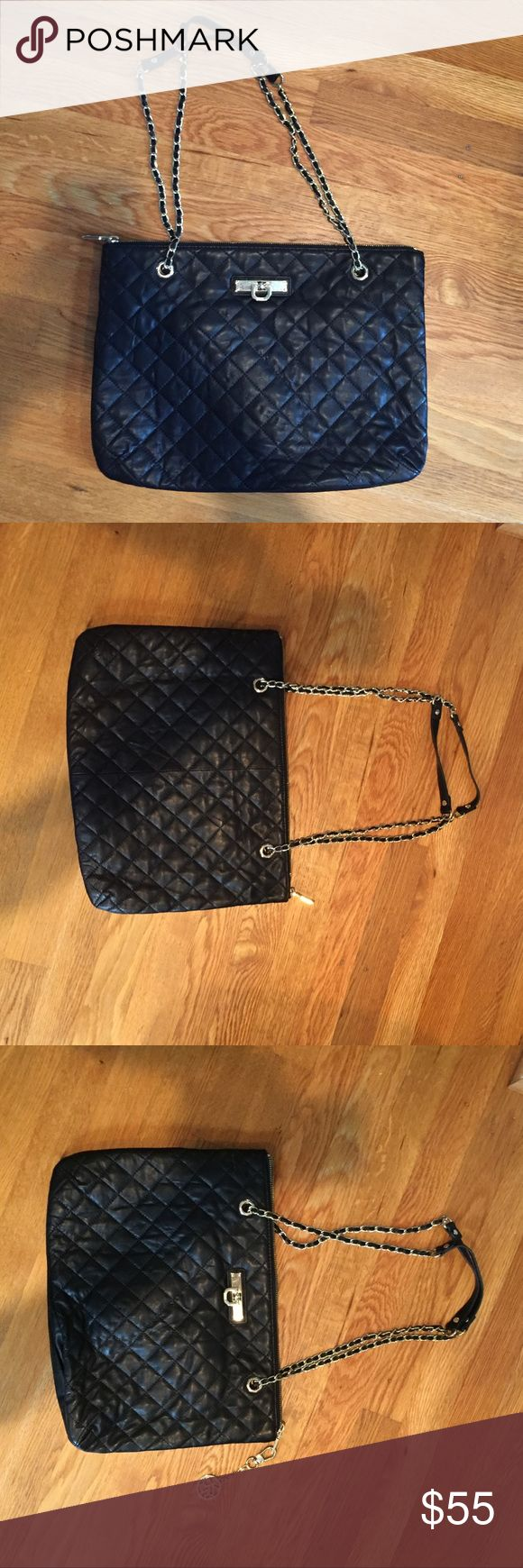 DKNY Black Quilted Shoulder Bag Excellent condition black quilted with gold hardware zip closure bag. Can be worn double strap over the shoulder or you can use a single strap and wear It cross body. Comes with detachable DKNY chain on zipper. Dkny Bags Shoulder Bags