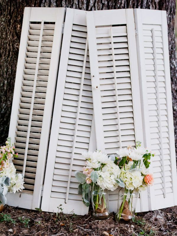 find old shutters at the flea market, yard sales or the salvage store to use as backdrops for other decor