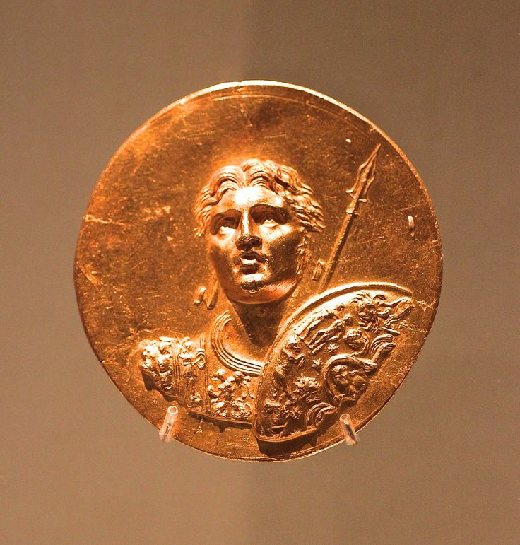 """Medallion with Alexander the Great. Roman Empire. Gold. this piece was discovered in Egypt as part of a hoard that comprised about 20 similar medallions, 18 gold ingots, & 600 gold coins issued by Roman emperors from Severus Alexander (r. AD 222-235) to Constantius I (r. AD 293-306). One of the medallions, now in the Calouste Gulbenkian Museum in Lisbon, bears an inscription that possibly reads """"Olympic games of the year 274"""", a date corresponding to AD 242-243. Picture by Eros Greatti."""
