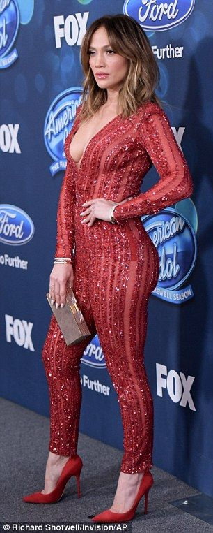 Perfect taste:The 46-year-old pop sensation showed up in a skintight red catpsuit which showcased her amazing figure