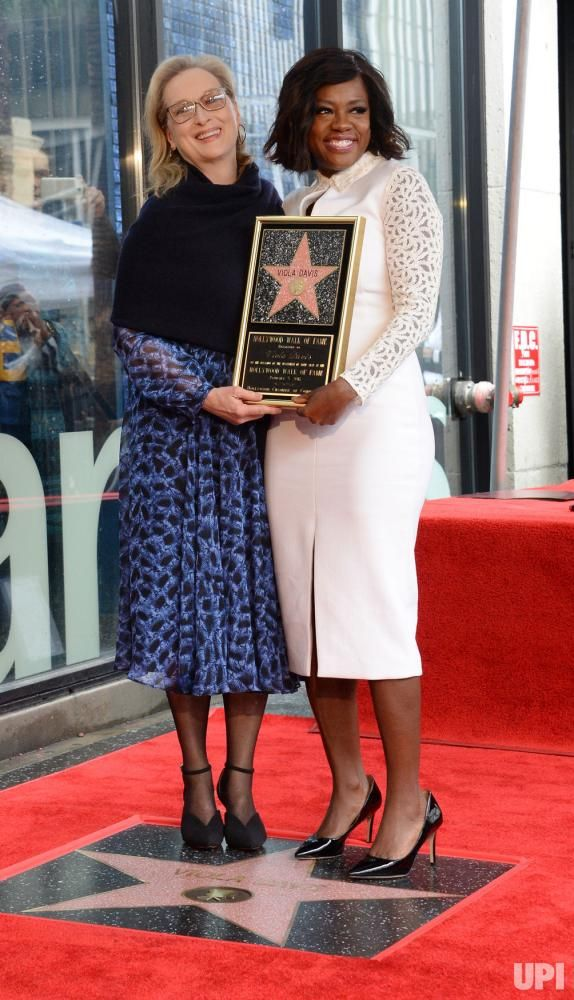 Actress Viola Davis holds a replica plaque as she is joined by actress Meryl Streep during an unveiling ceremony honoring her with the…