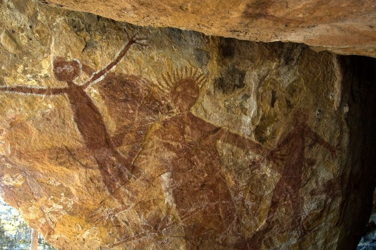 Quinkan spirit figures, identifiable by their long limbs and startled expressions, painted in ochre on sandstone in the Honeymoon Creek rock-art shelter on Cape York, Queensland.