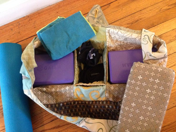 Interior of yoga bag with dividers for blocks, gloves, strap and phone.